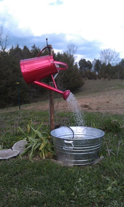 I made this garden fountain with a beautiful red sprinkling can and galvanized tub from my Tractor Supply Store. Added a small pond pump, and fed the water line up into the can. Now, I can't wait for the day lillies to get going !  It sounds SO nice !!