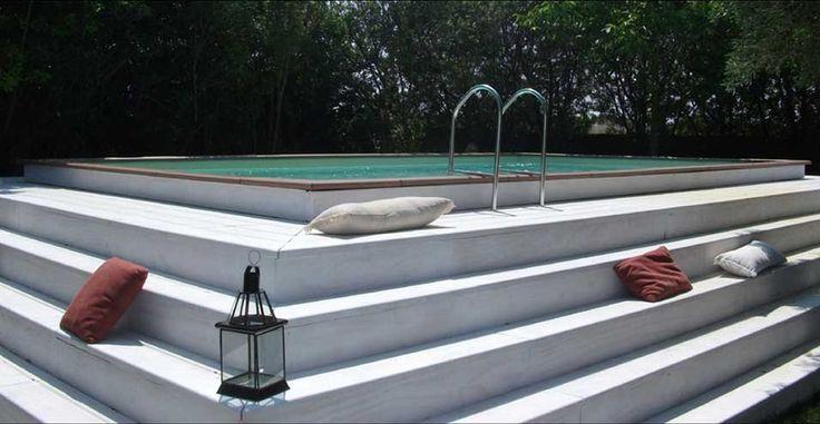 Piscine Hors Sol Laghetto Dolce Vita avec une terrasse en bois blanc : magnifique et design!