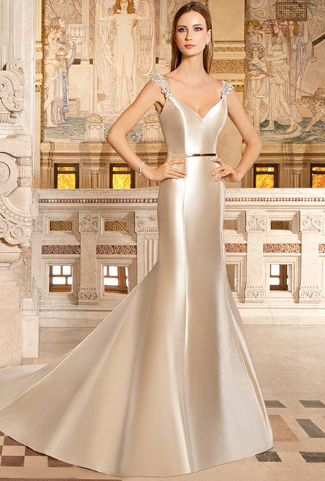 Demetrios - Illusions. This sultry mikado gown features a v-neckline, sheer jeweled cap sleeves and a semi-chapel train. The v-back is finished with covered buttons. Belt sold separately.