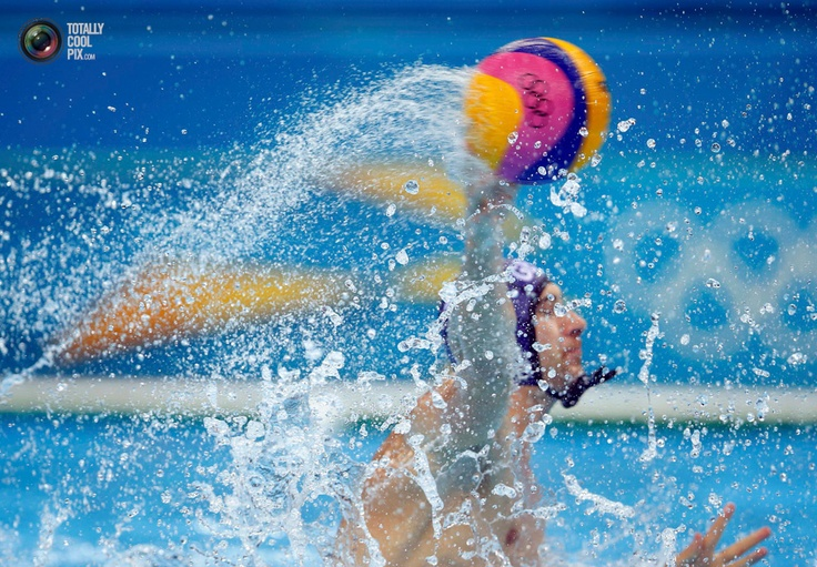 British player controls the ball during their men's preliminary round Group B water polo match against Serbia at the Water Polo Arena at the London 2012 Olympic Games. LASZLO BALOGH/REUTERS