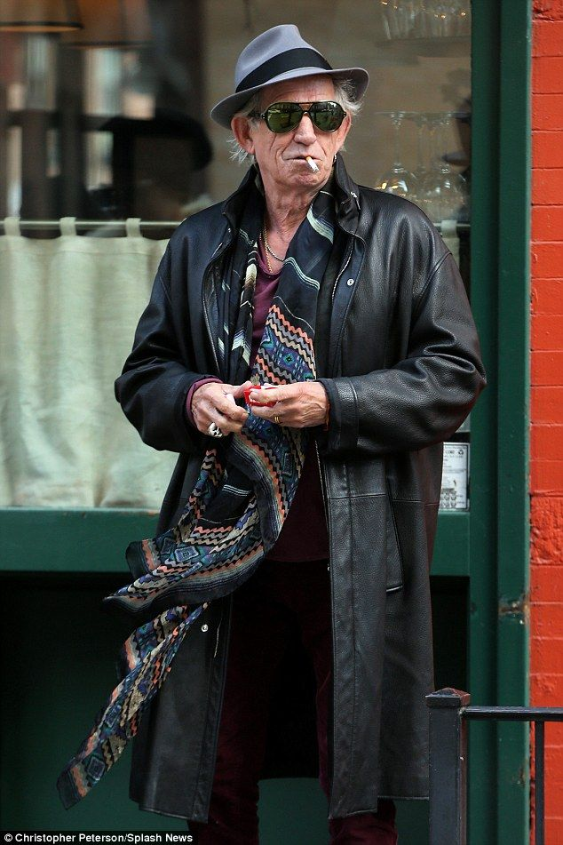 Bright young thing: The Rolling Stones rocker looked colourful in burgundy trousers and an Aztec scarf