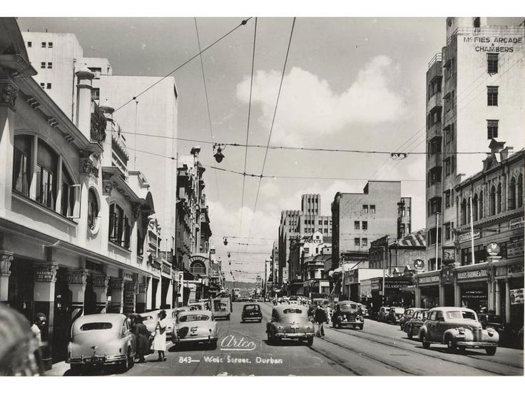 Looking up West Street towards the Berea, with Henwoods Ltd. on the front right, Durban.