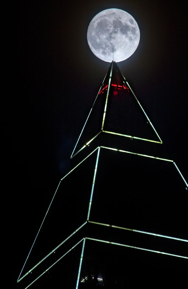 Full moon appears behind the Messeturm tower in Frankfurt am Main, western Germany, on November 13, 2016. Picture: AFP PHOTO / dpa / Frank Rumpenhorst