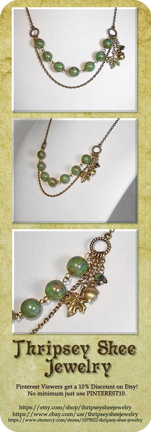 """This is beautiful forest themed necklace with 8mm semi transparent green beads with a striking bronze finish accented with an antique brass twisted rope chain. It has a bronze oak leaf and acorn charm to finish it off. The perfect necklace for this time of year! Necklace: 18"""" TSAdpin"""
