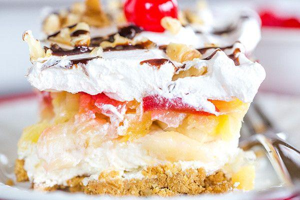 No-Bake Banana Split Dessert - Graham cracker crust, cream cheese, bananas, pineapple, strawberries, whipped cream, nuts, chocolate & a cherry!