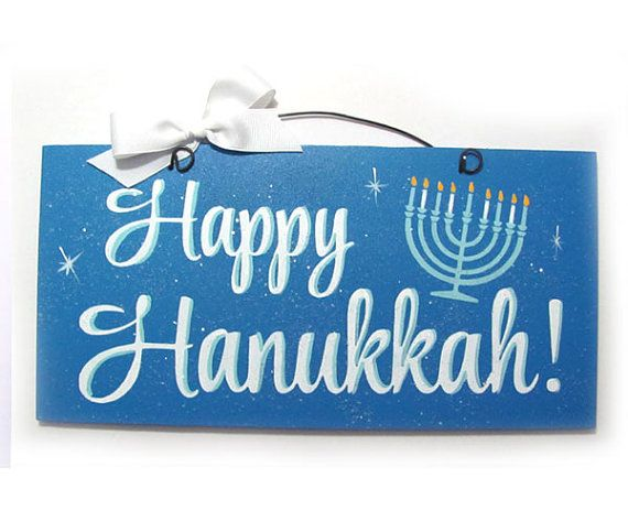 Happy Hanukkah sign with glitter.