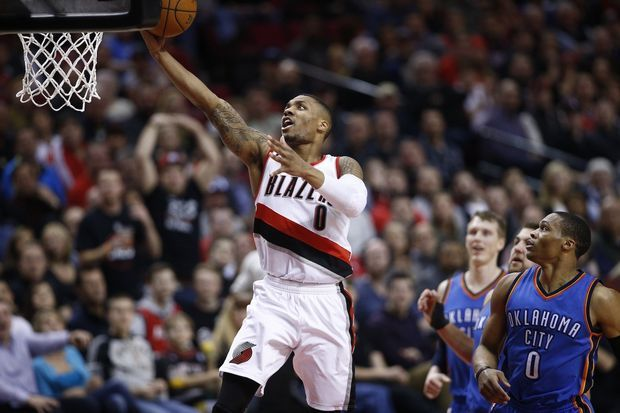 Damian Lillard (0) glides to the hoop as the Portland Trail Blazers face the Oklahoma City Thunder at the Moda Center on February 27, 2015. Bruce Ely / Staff