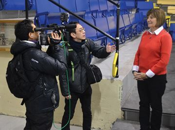 Film crew in Collingwood - TV Osaka host Yasuharu Hashiba interviews Collingwood Mayor Sandra Cooper at the Eddie Bush Memorial Arena.
