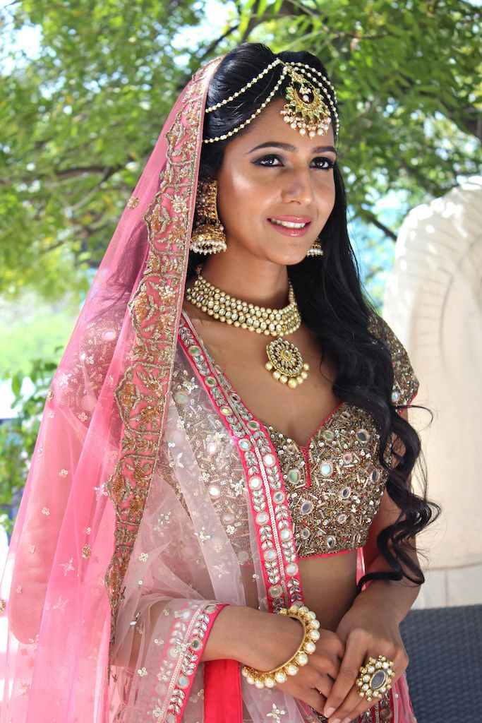 Bridal Portrait - Bride in a Silver and Pink Wedding Outfit with Gold Jewelry | WedMeGood #wedmegood #indianbride #indianwedding #bridal #bridalportrait #pink #gold
