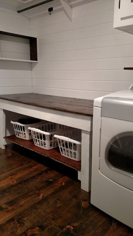 March 2016.  Laundry room after.  Stained pine floor, refurbished old farm table to be used as my folding table.