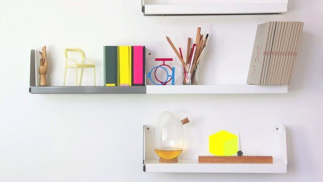 Double shelves host an animated adventure of objects designed by Sebastian Bergne.   Including the Egg Carafe from Designer Box, Monthly Measure from Atelier D'Exercices, Square chair from TOG and Double extending shelving from Tolix.