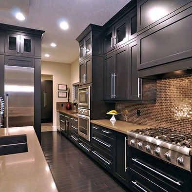 cabinets in dark espresso, white/gray counter top, glass mosaic backsplash