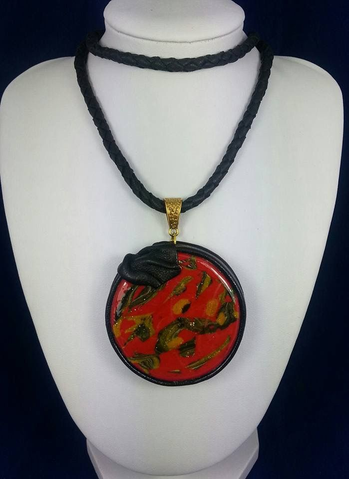 Pendant made of polymer clay and leather