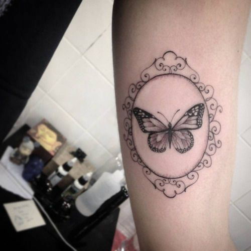Little butterfly tattoo on the tricep by Tattoo artist: Ivy...