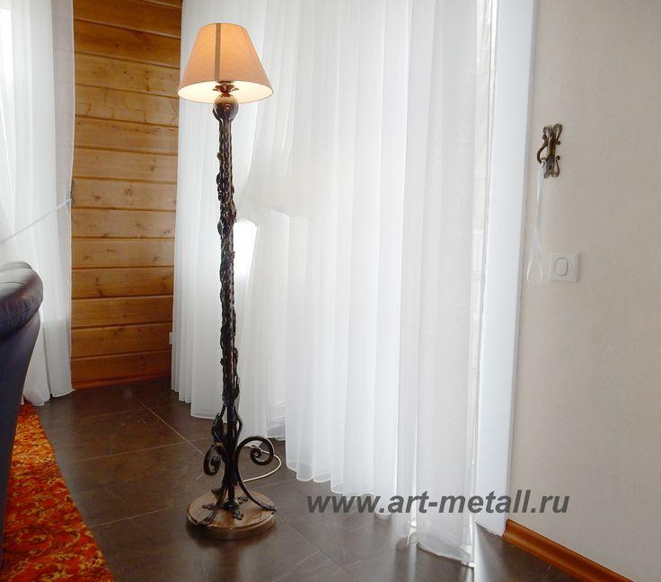 Wrought iron floor lamp.Oak base.