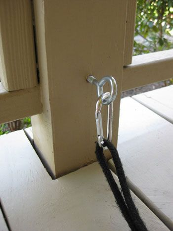 What a simple, yet great idea for the deck area or front porch, so that the dog can hang out while you lounge around on the lawn furniture...hook to hold the dog leash.