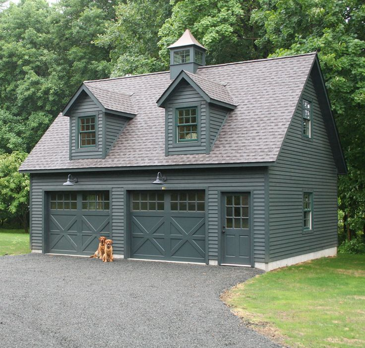 Love everything about this Kloter Farms 24' x 28' SmartSide garage. With a full second story, this garage has quite the potential. Looks like the pets are excited too! Adorable :)