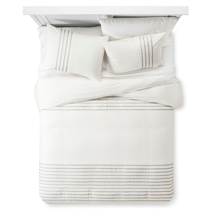 • Pure cotton exterior<br>• Plush polyester fill<br>• Embroidered accenting<br>• Hidden buttons<br>• Includes duvet and matching shams<br>• Machine washable<br>• Available in standard mattress sizes<br><br>Enjoy a peaceful night's sleep covered in the luxurious softness of a Nate Berkus, Embroidered Duvet and Sham Set. Eye-catching gathered stripes and intricate embroidered detai...