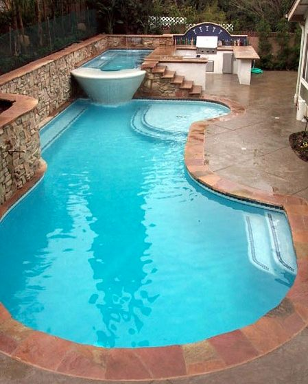 pool, hot tub and outdoor kitchen