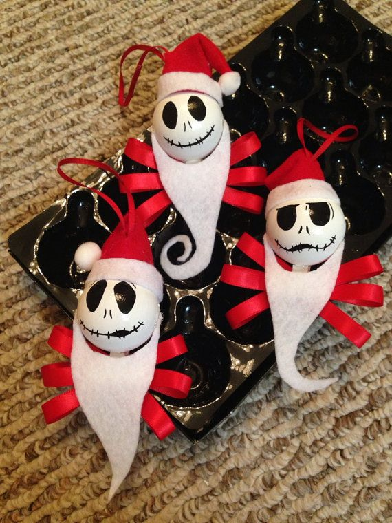 These glass ornaments are 2 inches by 2 inches.  This set includes 3 Jack Skellington Santa Claus ornaments.  They are hand painted with acrylic