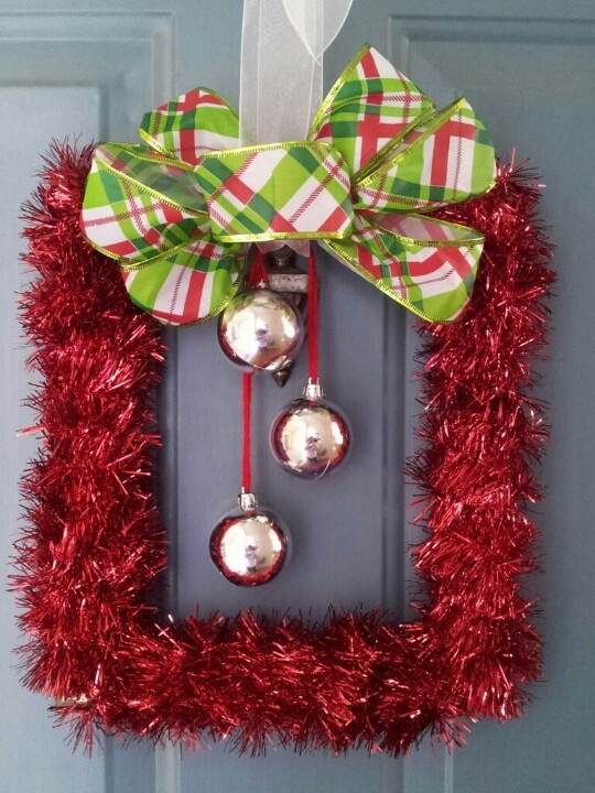Square Christmas wreath. Dollar store frame garland ribbon and Christmas bulbs:)