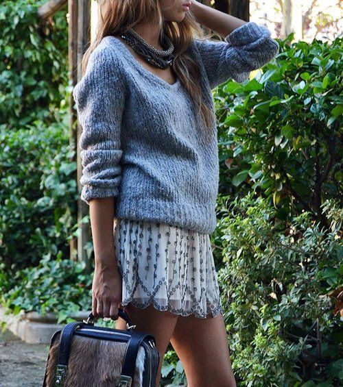 I really like the idea of a pretty skirt with over sized sweater