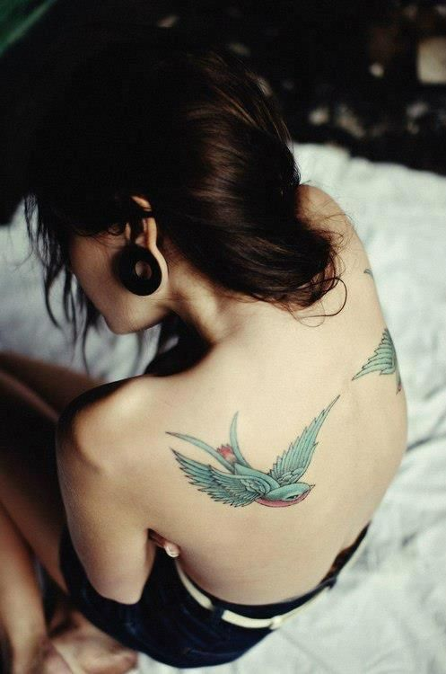 Swallows on the back of this girl. #tattoo #tattoos #ink