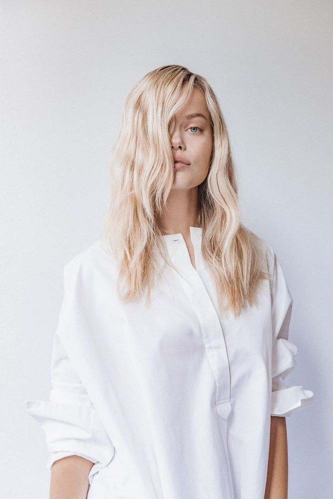 Hairstylist Holly Mills on the pinning and styling tutorial for air drying straight hair into gorgeous waves.