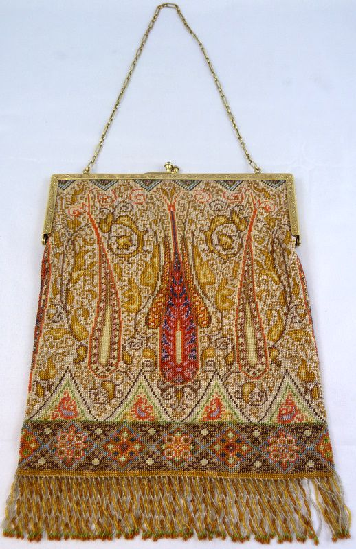"""TIFFANY & Co 14K FRAME VINTAGE BEADED TAPESTRY BAG - Fabulous Tiffany & Company hand made micro bead purse. Has a scrolled pattern with reds, blues, browns, pinks, greens and gold. Has 14k yellow gold frame with hand chased floral decoration and chain link strap. Has cabochon sapphires set to clasp. Braided fringe design to bottom. Interior is champagne silk. Measures 9 1/4"""" height x 6 7/8"""" width"""