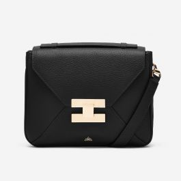 <p>The Mini Berlin is the most charming companion. Crafted in luxurious calf leather with pale gold hardware, it can be worn cross-body, over the shoulder or as a clutch thanks to its removable strap. This unique little bag adds modern edge to any look.</p>