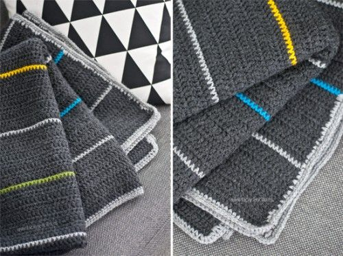 Grey, crocheted blankets with a few colorful stripes thrown in. -- from Shelterness.com