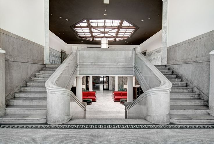 Modern Staircase with Double staircase, limestone floors