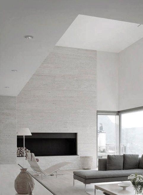 Pale grey vein cut travertine walls | contemporary living space || Sofa Charles B Italia