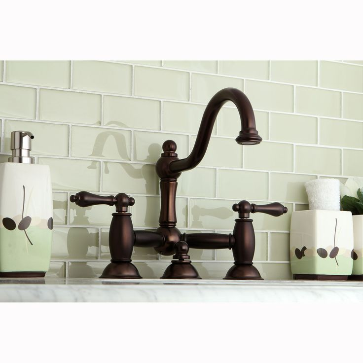 Kingston Brass Victorian Bridge Oil Rubbed Bronze Bathroom Faucet (Oil  Rubbed Bronze)