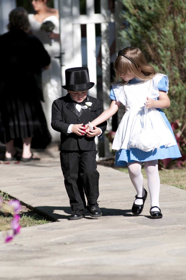 alice! for alice in wonderland wedding!cute idea for flower girl and madhatter!