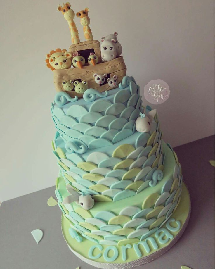 Noah's ark christening or birthday or baby shower cake with animal toppers and wave effect.