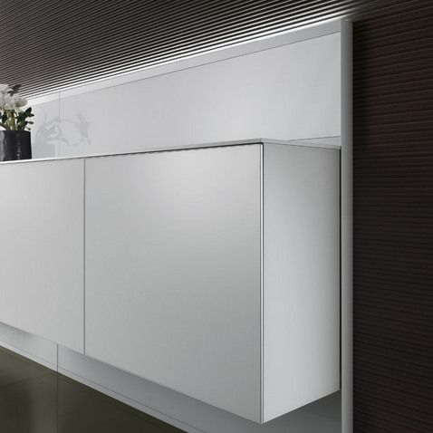 completely in lacquered glass the units with coplanar sliding doors can be displayed with back