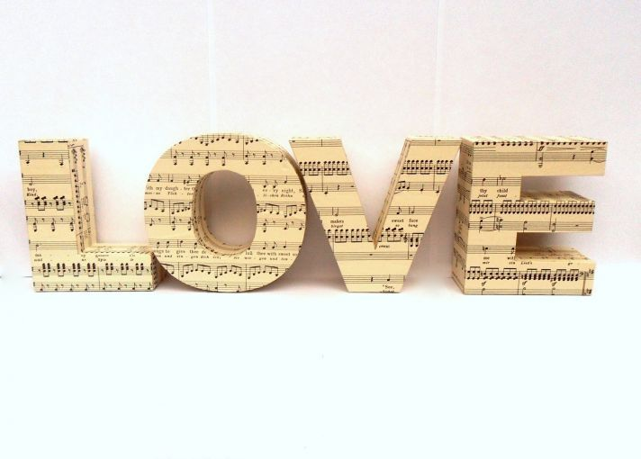 LOVE blocks covered in sheet music. this would be great for the entry way to the reception.