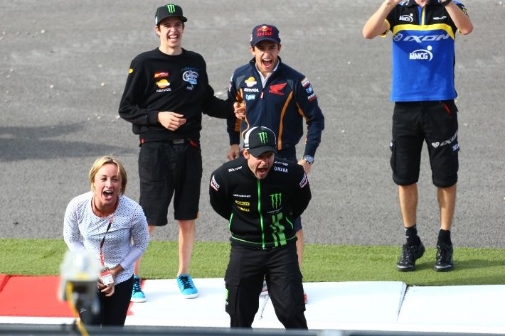 Marquez brothers and Crutchlow cheering running race, British MotoGP 2013