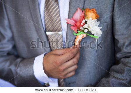 Wedding Boutonniere On Jacket of Groom. Elegant classic colorful buttonhole with amazing flowers and orange rose on groom's wedding suit. St...