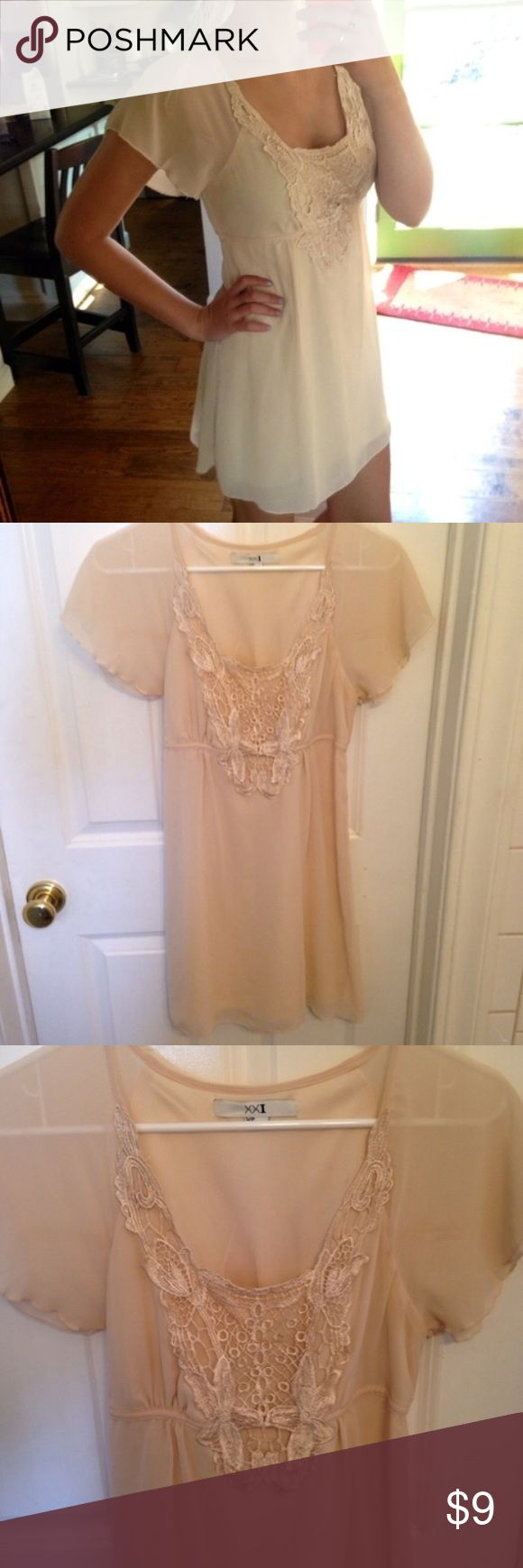 """Super cute beige summer/formal occasion dress Beautiful, high quality dress from Forever 21. The color is a nice beige with a slightly pink tint. It has detailed embroidering on the front and ties in the back. I wore it once to a wedding and don't plan on wearing it again! Could be casual or formal depending what shoes you wear with it. Size small. Is pretty short on me but I'm 5'8"""" and my legs are pretty long! Forever 21 Dresses Mini"""