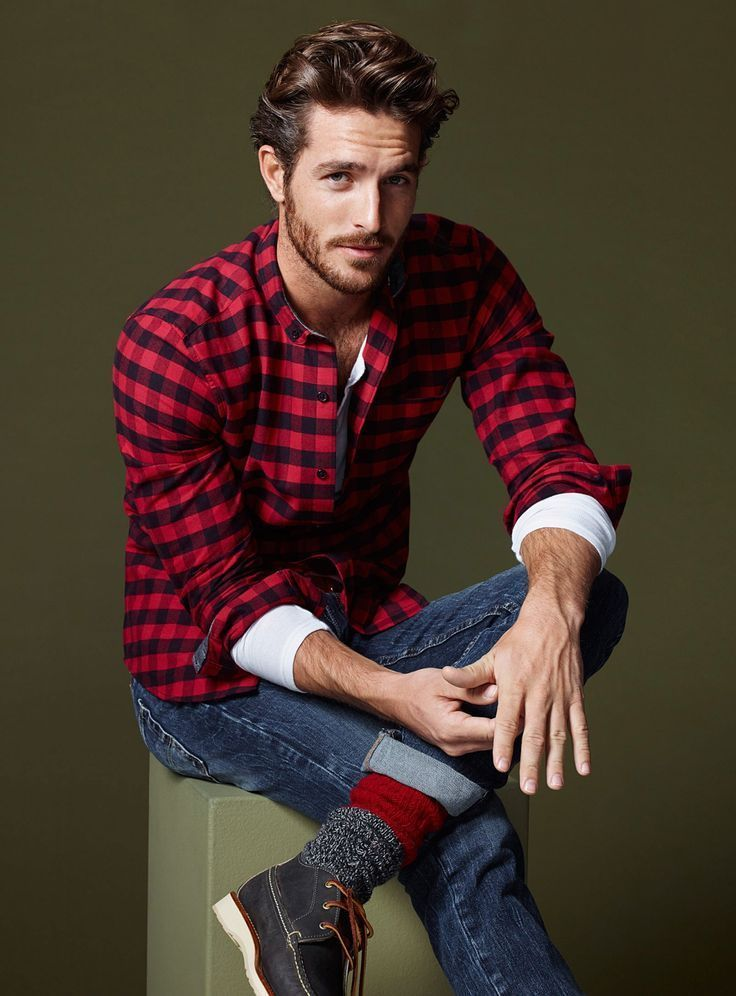Shop this look on Lookastic: https://lookastic.com/men/looks/long-sleeve-shirt-henley-shirt-jeans-boat-shoes-socks/12831 — Red and Black Gingham Long Sleeve Shirt — White Henley Shirt — Navy Jeans — Red Socks — Black Leather Boat Shoes