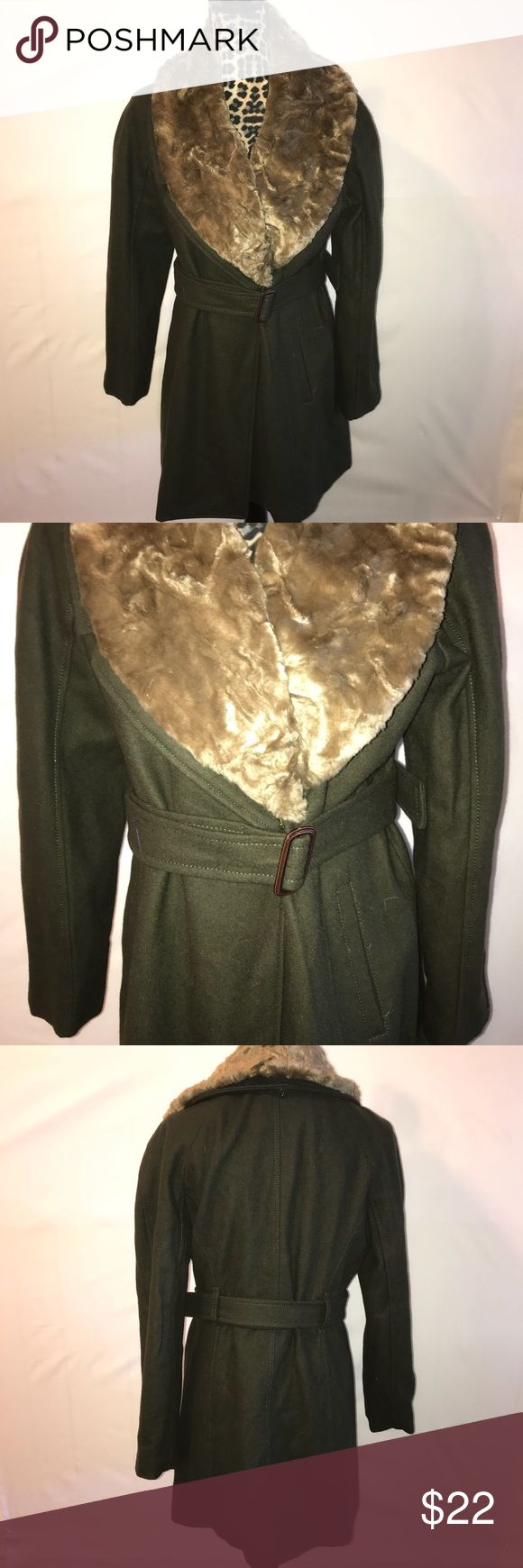 Women's Sz12 Nine West coat. Olive green faux fur Size 12 women's olive green coat. Has a removable faux fur collar and a belt that can be removed as well for a custom look. This is in gently used condition and shows hardly any wear. One of the buttons that connects the faux fur is a bit loose but doesn't affect the purpose of it. It still hold the fur in place. I am selling much cheaper because of that minor flaw. Other than that, it's in good used condition. Nine West Jackets & Coats