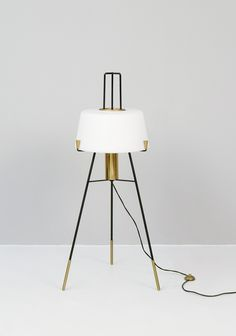 A stunning brass, black metal, and white frosted glass midcentury floor lamp: quintessential Stilnovo!