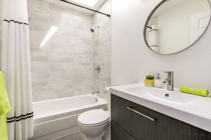 Light grey bathroom. Light grey tile. Ikea bath unit.
