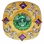 "This is a true masterpiece of creative gold work and jewelry design. This top quality minty blue green tourmaline is masterfully bezel set on a stage of gold with four bezel set deep lavender princess cut natural amethyst. Check out the uniqueness of the bezels. The fun"" butterflies motif"" is creatively done in diamond melee, all of which is then highlighted by a unique Florentine finish on the gold. This is all hand done. The underside of the ring is even more amazing with all the attention"