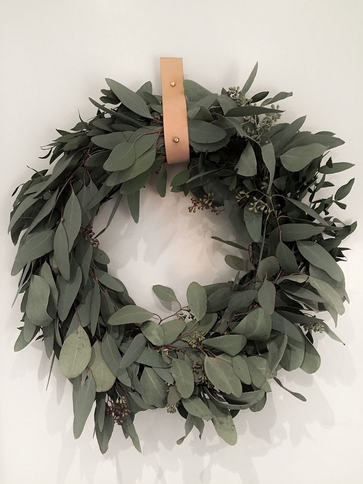 Eucalyptus christmas wreath with leather strap. By instagram studio.jb.stockholm