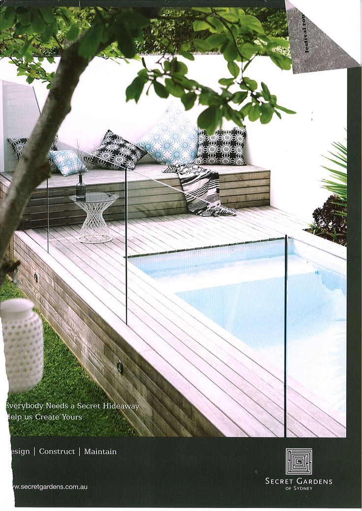 Raised pool decking around small pool - talk about dreaming but how nice!