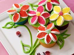 """These beautiful spring cupcakes were created and shared by our friends Alan Richardson and Karen Tack, authors of the hugely popular cookbooks """"Hello, Cupcake!"""" and """"What's New, Cupcake?"""""""
