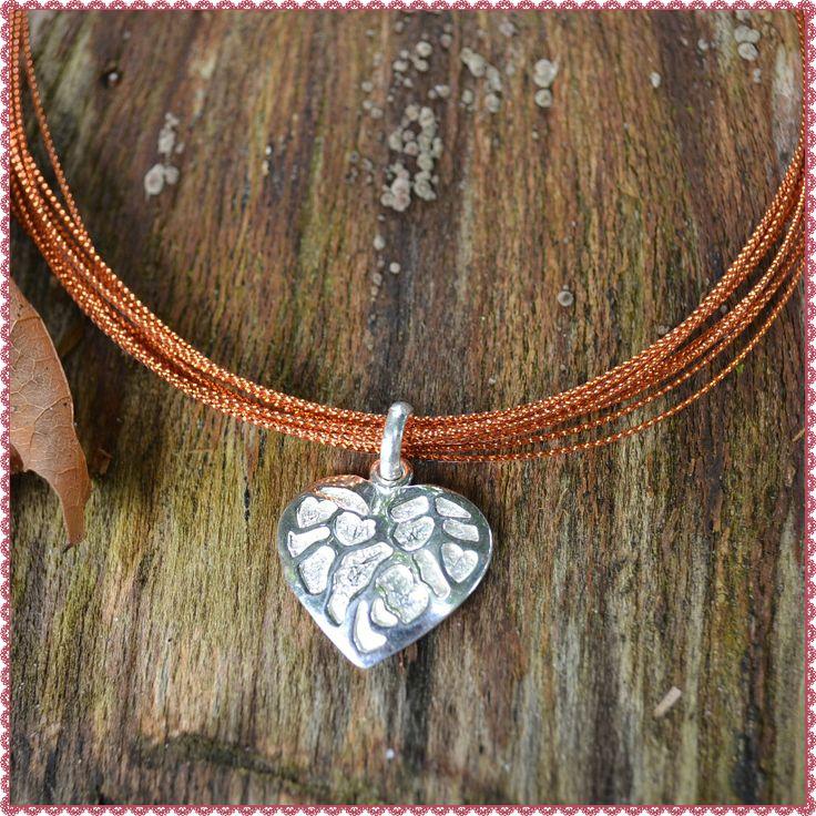 Prachtige orange ketting met zilveren sluiting http://www.dczilverjuwelier.nl/